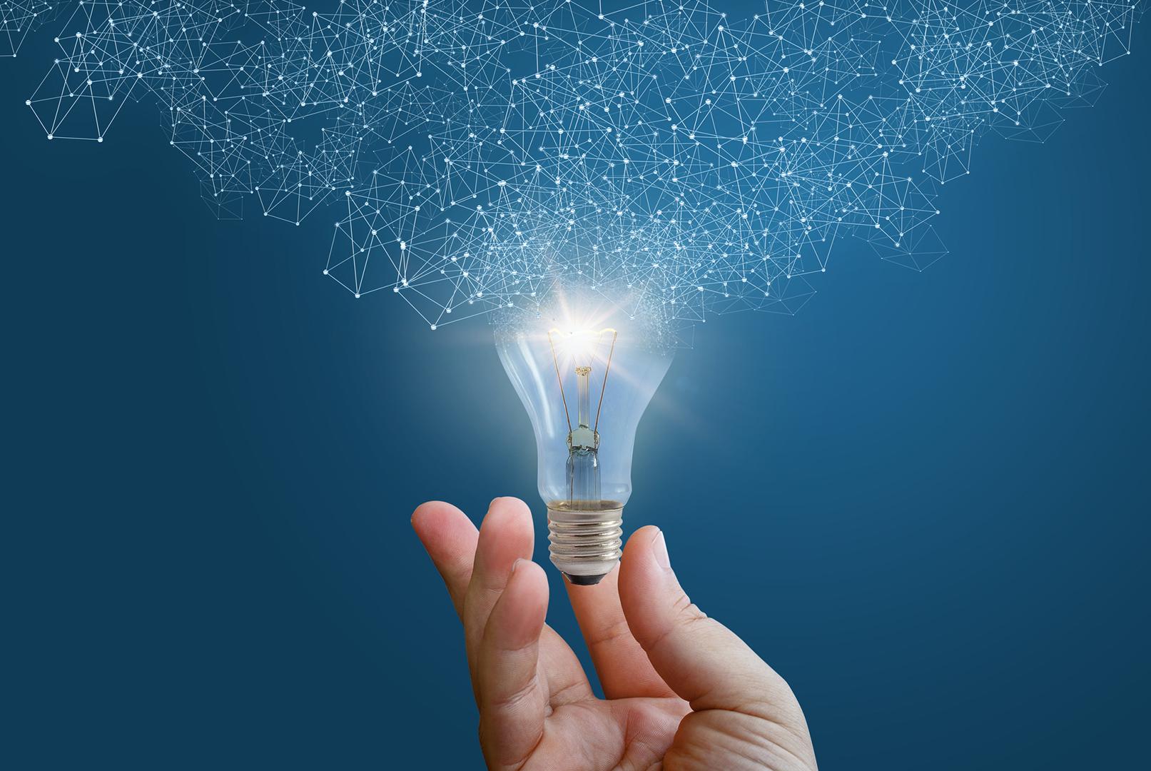 iStock-670953786-hand-lightbulb-intelligent-automation-blog